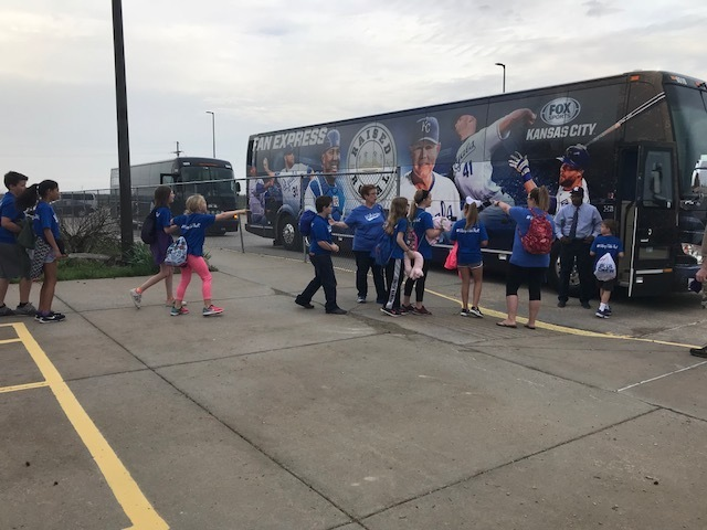 "Students loading buses for the ""Day at the K"""