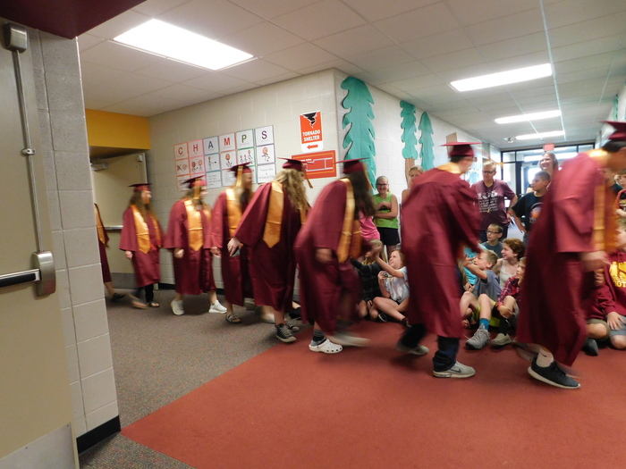 Seniors Walk through the halls