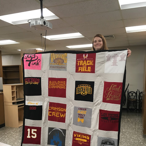 Brogan and her t-shirt quilt