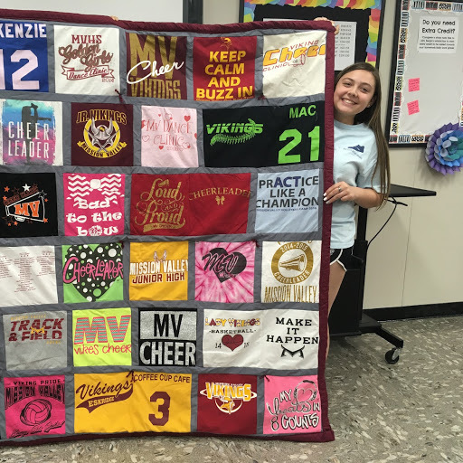 Kenzie and her tshirt quilt