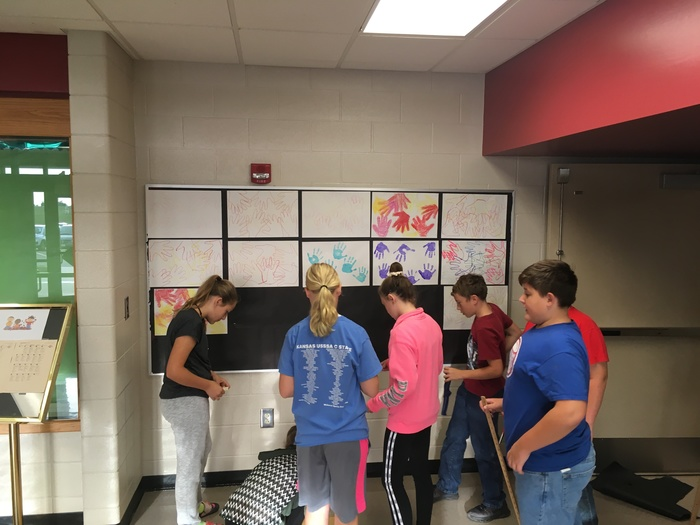 6th Grade students working on the Elementary Bulletin Board