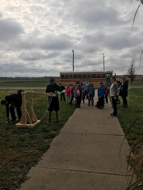 HS students using their student created catapults