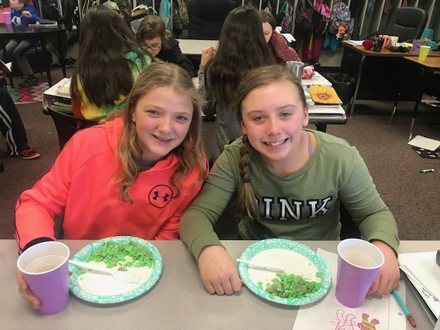 Fifth graders eating Green Eggs & Ham for Dr. Seuss Week