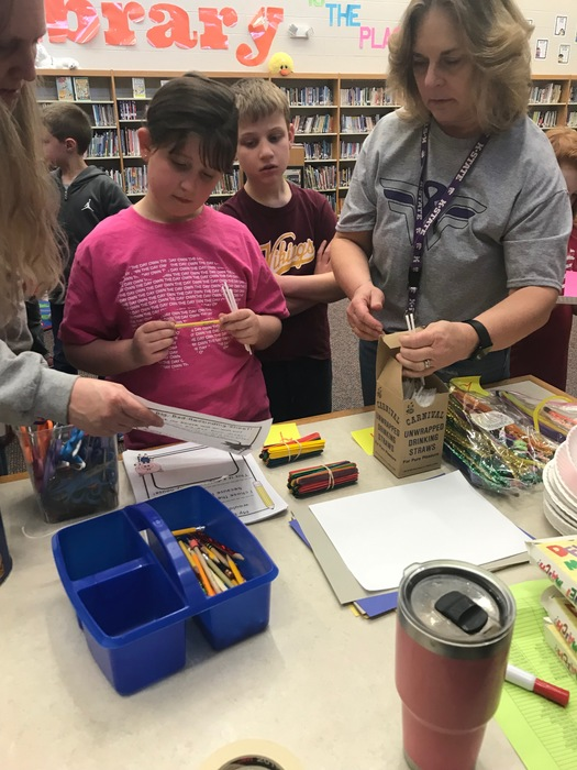 2nd Graders gathering supplies