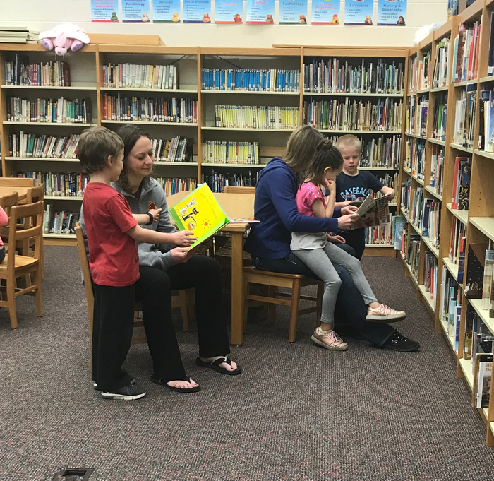 Students and Paras enjoying Library time this morning.