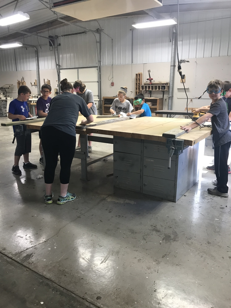 Student ambassadors working on benches