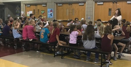 Summer reading students listening to Mrs. Johnston