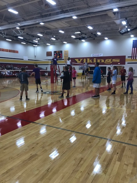 8th graders getting set for their Volleyball game