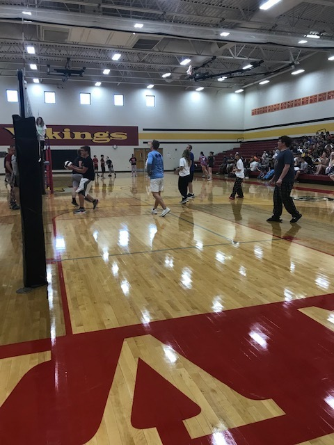 Seniors playing the Staff in volleyball