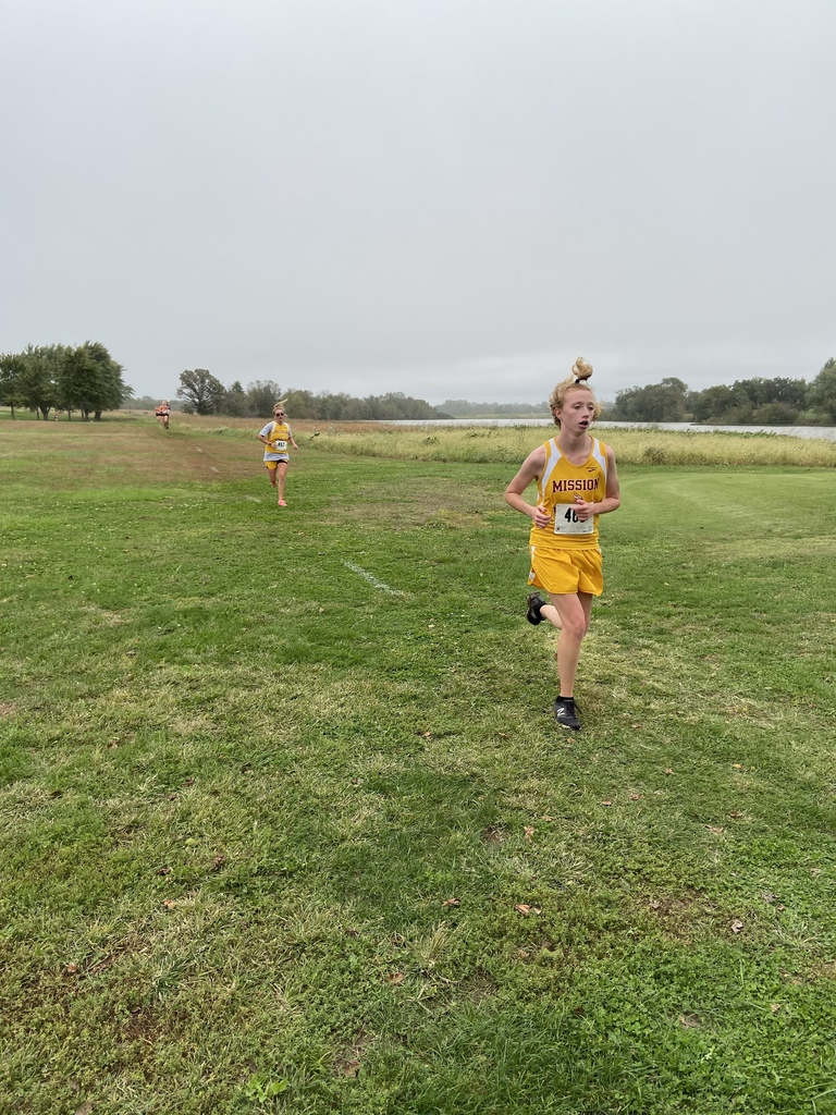 Hannah and Raven running at Osage City