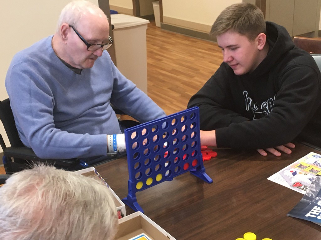 Students playing a game with a VA resident