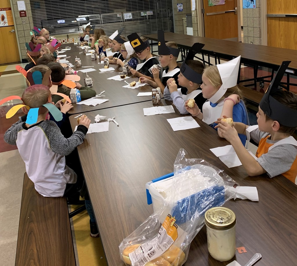 Kindergartners celebrating Thanksgiving with homemade butter
