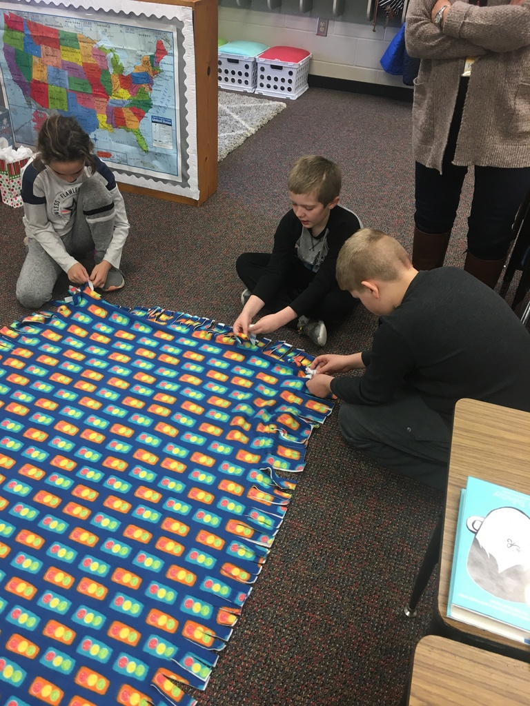 4th grade students working on Project Linus Blanket