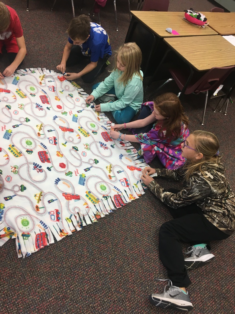 4th grade students working on Project Linus Blankets