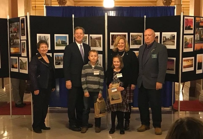 Sam Rogers with his winning photo and the Governor