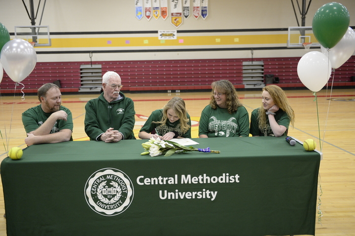 Rachel Halupa signing her letter of intent to play softball at Central Methodist University