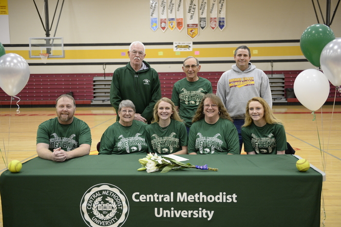 Rachel Halupa signing her letter of intent to play softball at Central Methodist University and her family